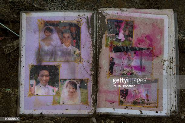 Family photos washed away from the tsunami have been found and displayed at a makeshift evacuation center so that people can collect them on March 26...