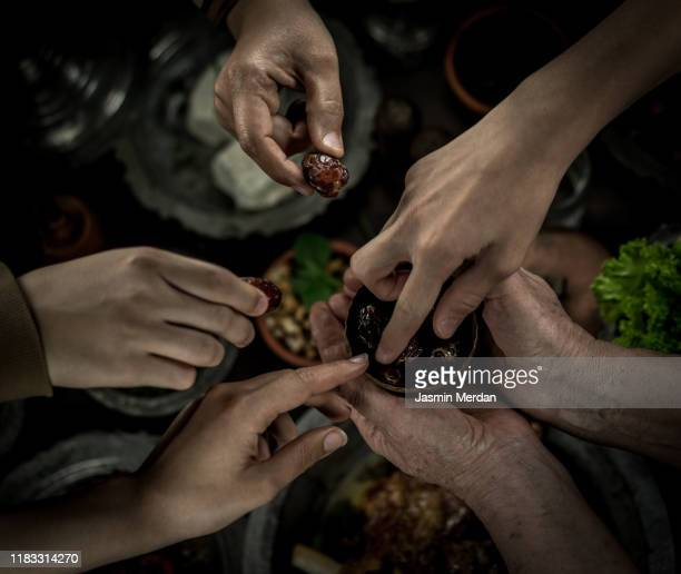 family picking dates before dinner - persian gulf countries stock pictures, royalty-free photos & images