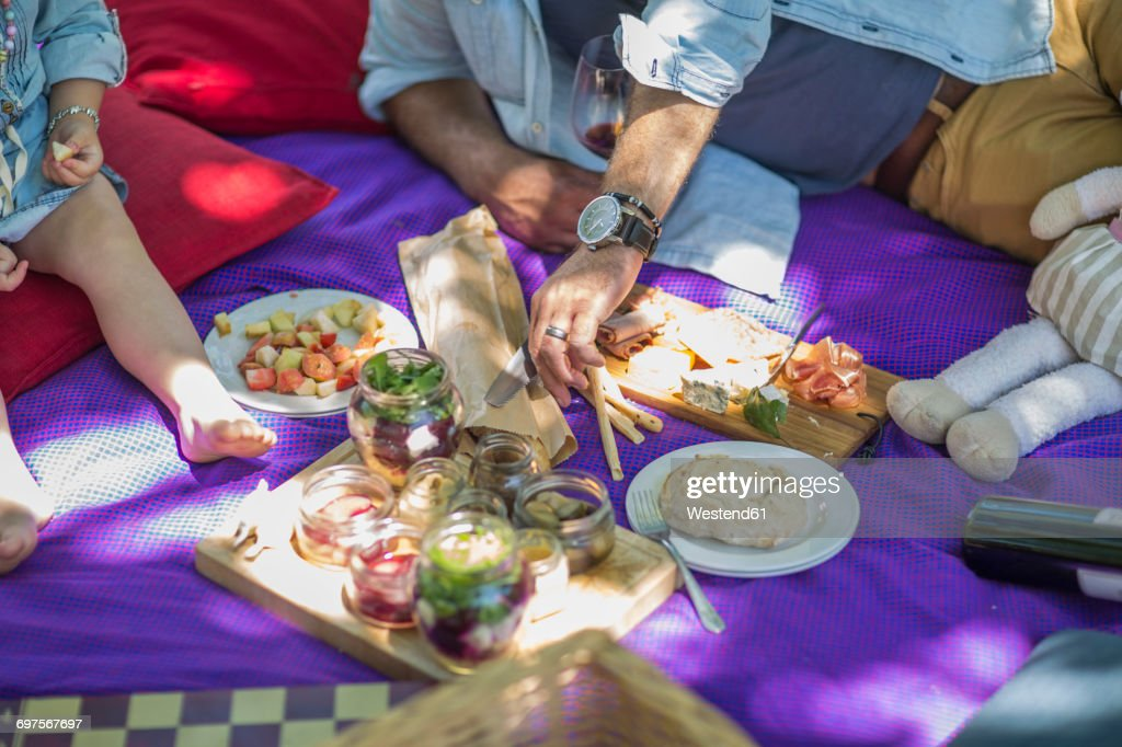 Family picnic with food and snacks : Stock Photo