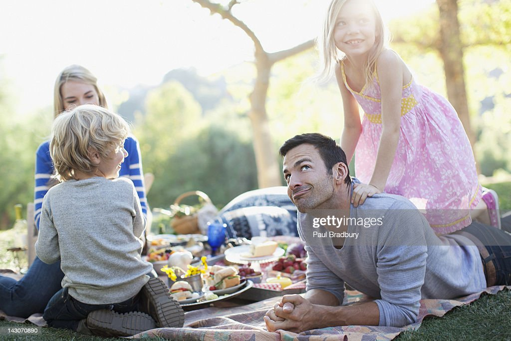 Family picnicking in grass : Stock Photo
