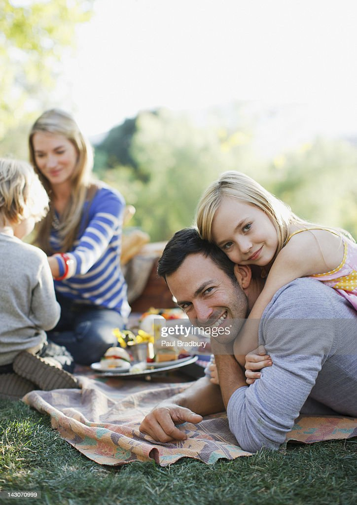 Family picnicking together outdoors : Stock Photo