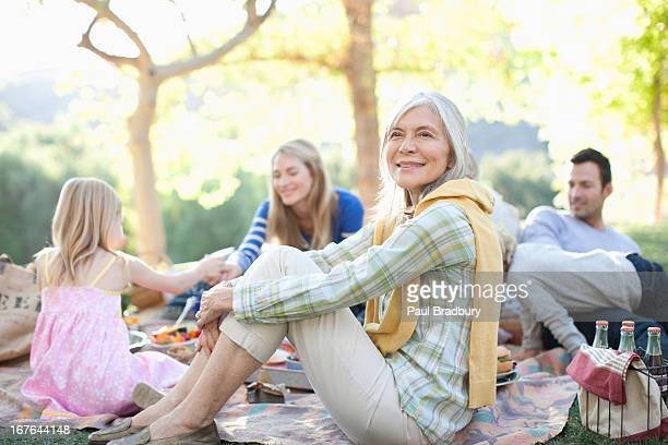 family picnicking together outdoors - focus on foreground stock pictures, royalty-free photos & images