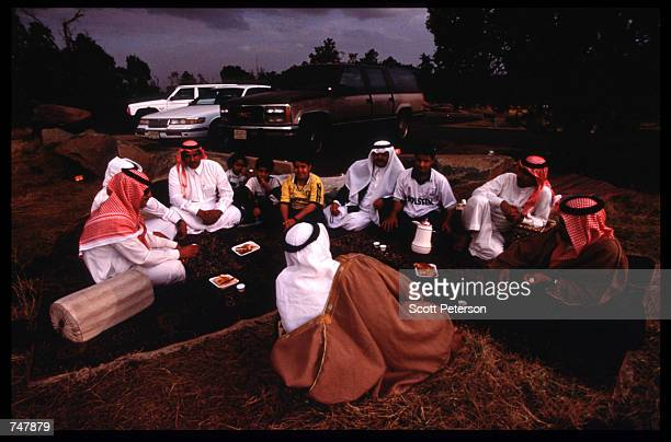 A family picnics near the peak of AlSooda August 15 1997 in Abha Saudi Arabia Near the Red Sea the Asir Mountains are a popular destination for...