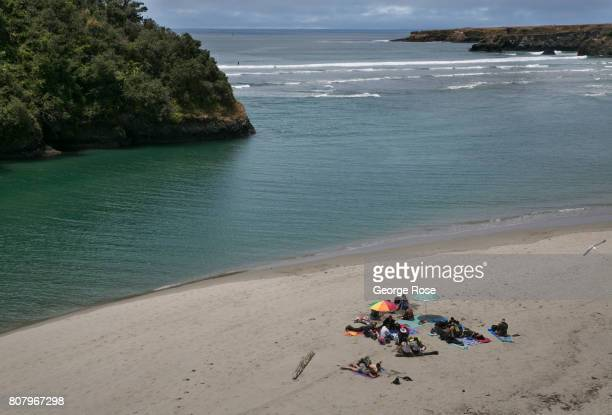 A family picnics on the beach at the mouth of the Big River on June 24 in Mendocino California The Mendocino Coast located along the rugged Northern...