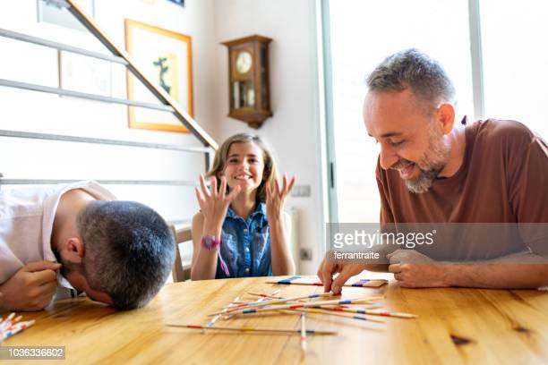 lgbt family - board game stock pictures, royalty-free photos & images