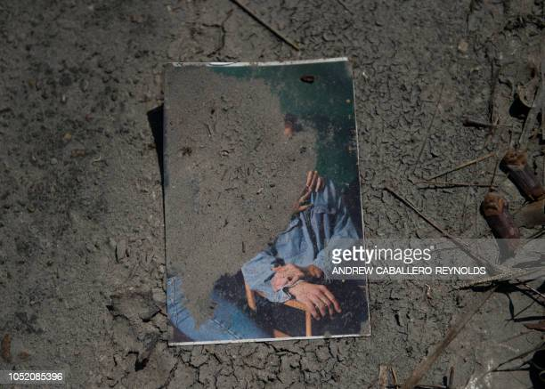 A family picture lies in the mud after being washed out in a storm surge in Port St Joe beach Florida on October 13 three days after hurricane...