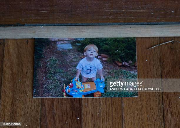 A family picture lies on the floor of a house damaged by a storm surge in Port St Joe beach Florida on October 13 three days after hurricane Michael...