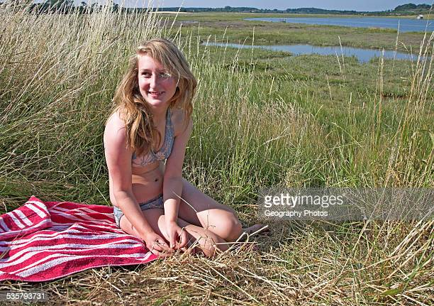family picture of teenage girl sitting in the countryside Butley Creek Suffolk England