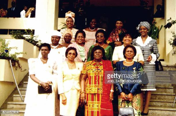 Family picture of the First ladies or their representatives 17 May 2001 on the opening day of the African 'First ladies' summit in Libreville Edith...