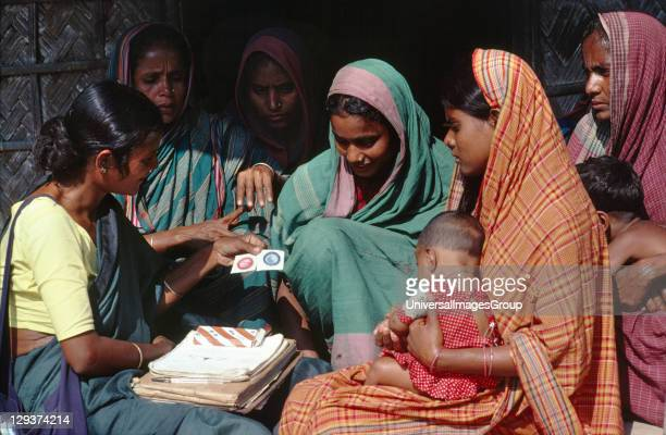 Family Planning Bangladesh Mobarakdi Village Matlab District Hashina Akhtar Showing Women How To Use A Condom She is a community health worker She...