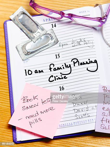 family planning clinic appointment in diary - pap smear stock photos and pictures