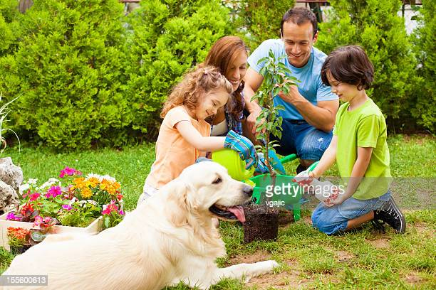 Family Planting Tree Together.