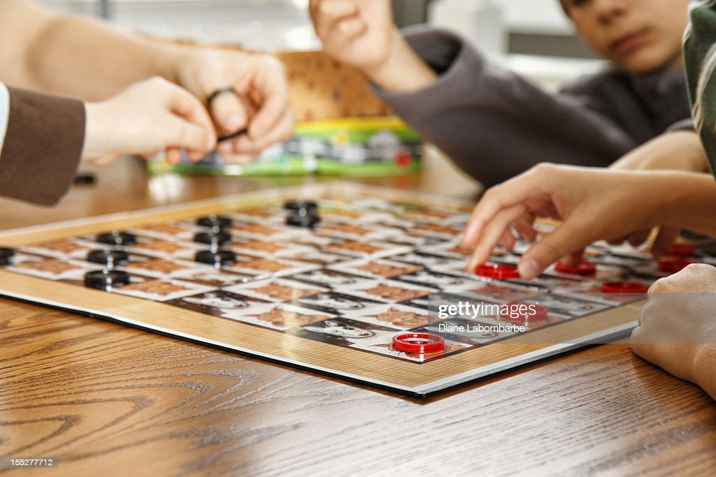 Family Playing A Board Game Together : Stock Photo