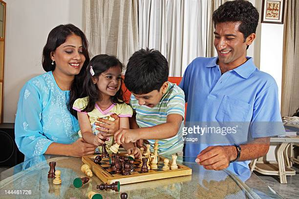 A family playing a game of chess