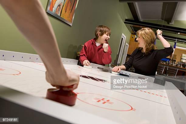 Family playing air hockey