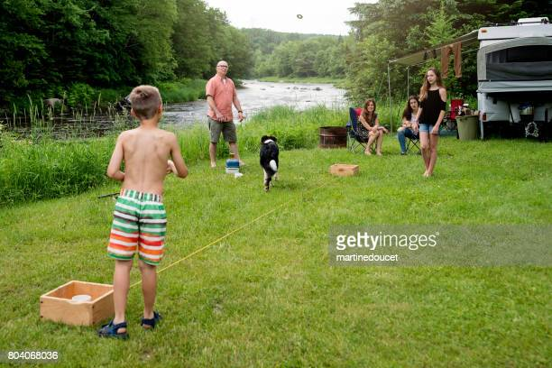 Family playing and relaxing in summer camping.