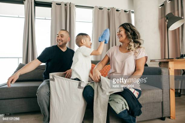 A Family Playing Around at the Living Room