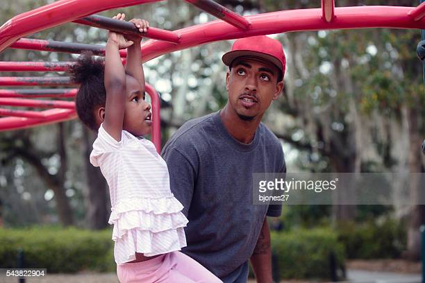 family playing at park - uncle stock photos and pictures