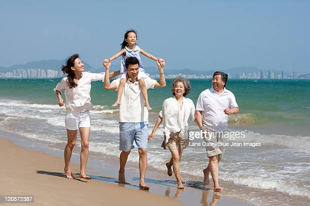 family playing at the beach - women in wet t shirts stock pictures, royalty-free photos & images