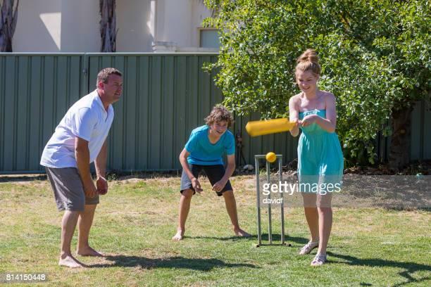 Family Playing Backyard Cricket