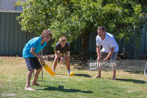 family playing backyard cricket - sport of cricket stock pictures, royalty-free photos & images