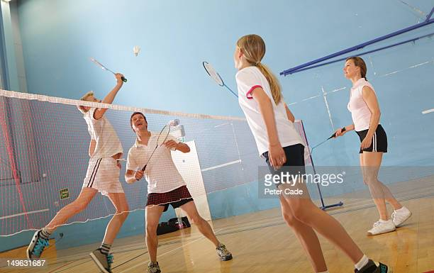 family playing badminton - badminton stock photos and pictures
