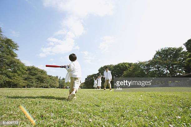 family playing baseball - baseball mom stock pictures, royalty-free photos & images