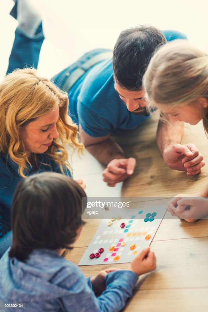 Family Playing Board Game At Home : Stock Photo