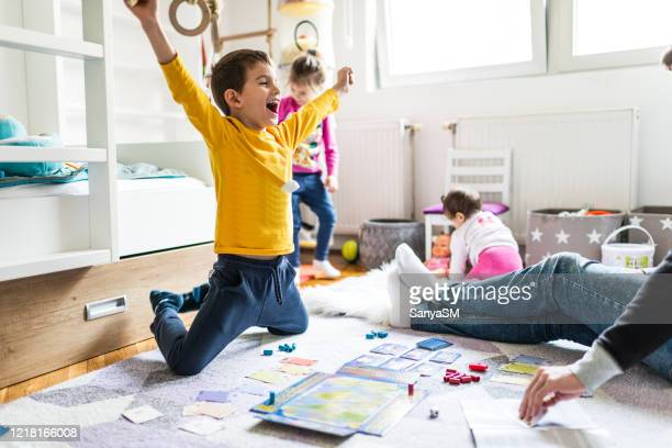 family playing board game - leisure games stock pictures, royalty-free photos & images