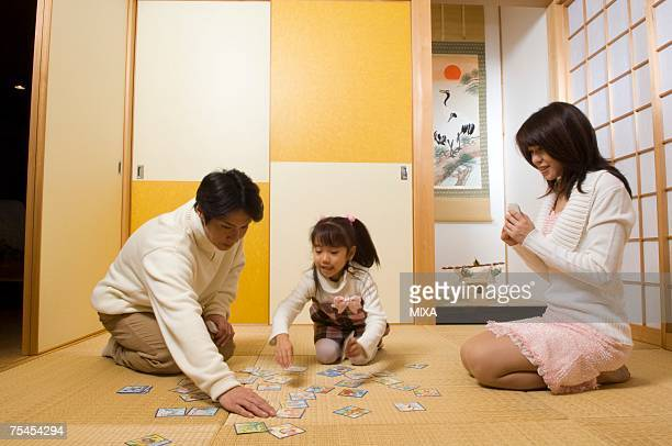family playing card game - new year's day stock pictures, royalty-free photos & images
