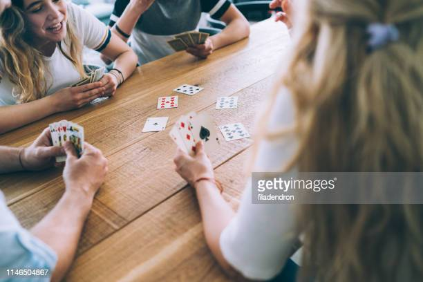 family playing cards - leisure games stock pictures, royalty-free photos & images