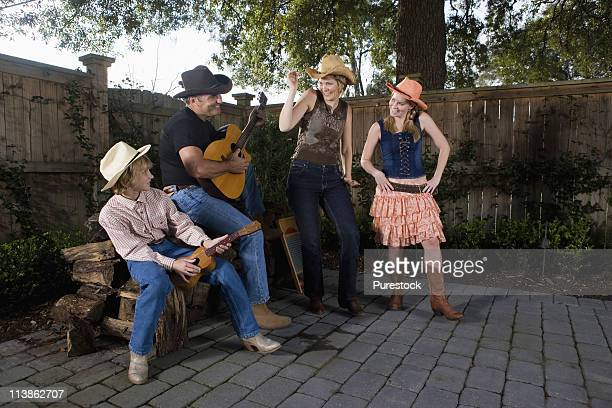 Family playing country music and dancing together