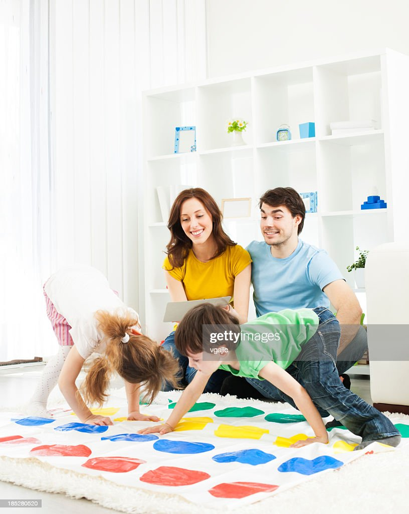 Family playing floor game. : Stock Photo