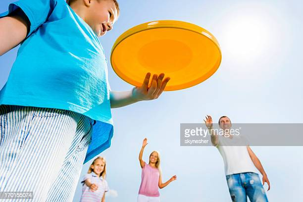 Family playing Frisbee.