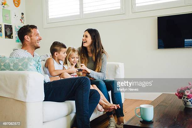 family playing games on the couch