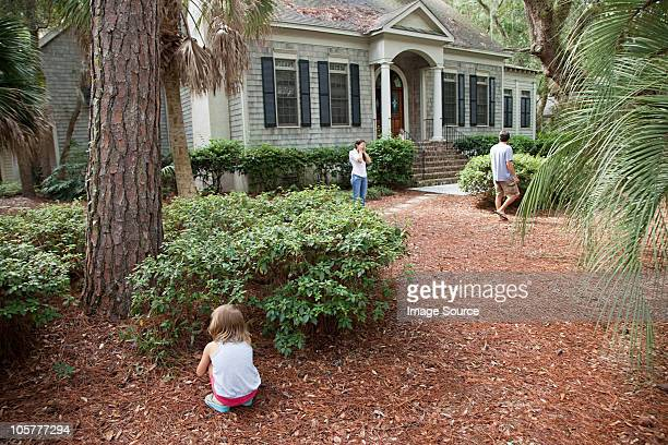 Family playing hide and seek in garden