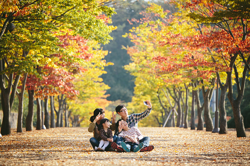 Family playing in autumn park - gettyimageskorea