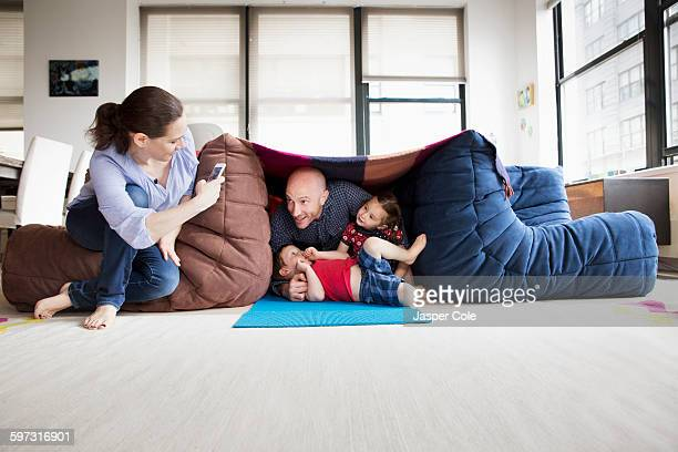 family playing in blanket fort - fortress stock pictures, royalty-free photos & images