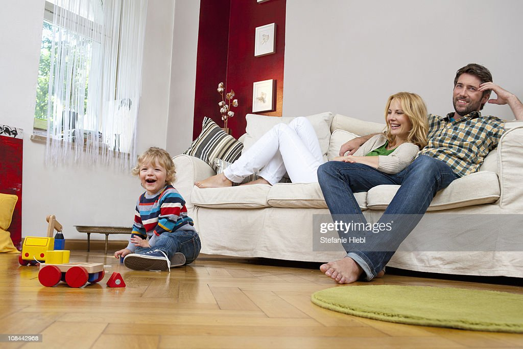 Family Playing In Living Room High-Res Stock Photo - Getty ...
