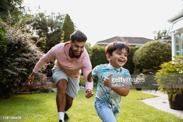 family playing in the garden - messing about stock pictures, royalty-free photos & images