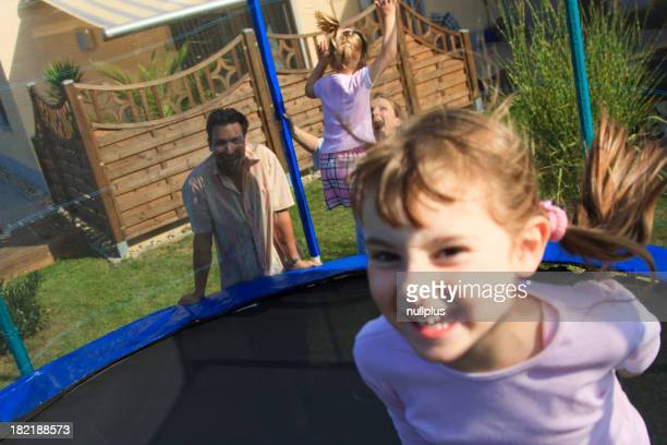 family playing in the garden
