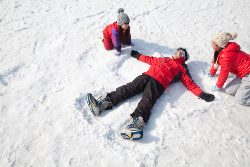 Family Playing in the Snow, Father Making Snow Angel - gettyimageskorea