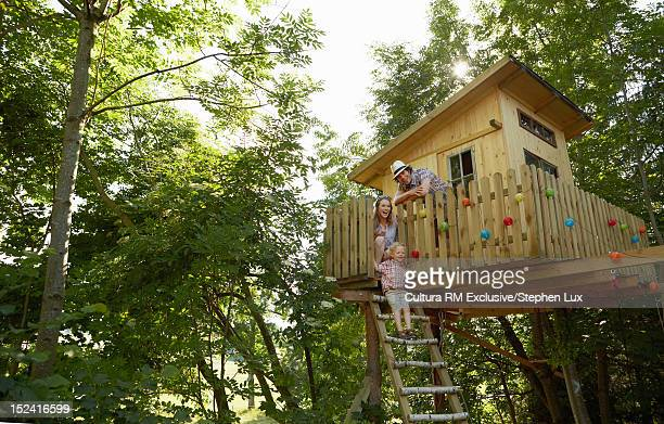 Family playing in tree house