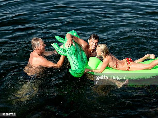 family playing in water - sea swimming stock pictures, royalty-free photos & images