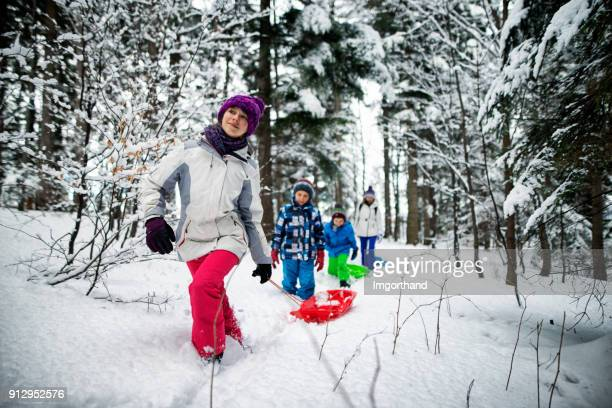 Family playing in winter forest