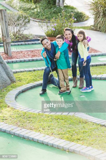 family playing miniature golf - vertical stock pictures, royalty-free photos & images