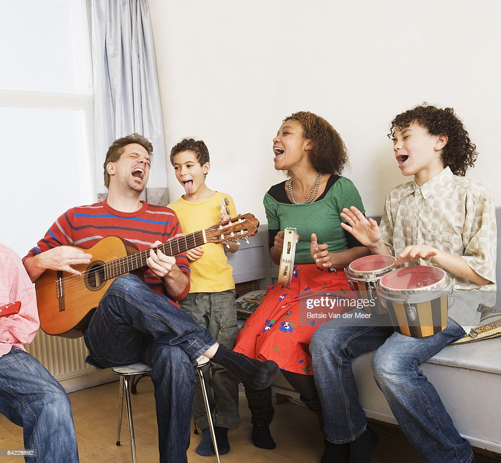 Family Playing Music after Online Music Lessons