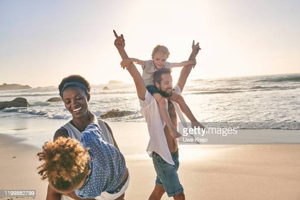 family playing on beach - female hairy chest stock pictures, royalty-free photos & images