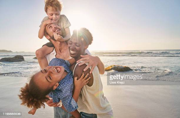 family playing on beach - south africa stock pictures, royalty-free photos & images