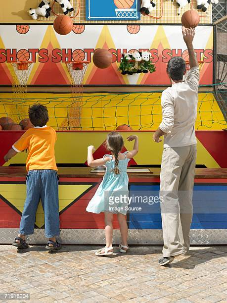 Family playing on fairground stall